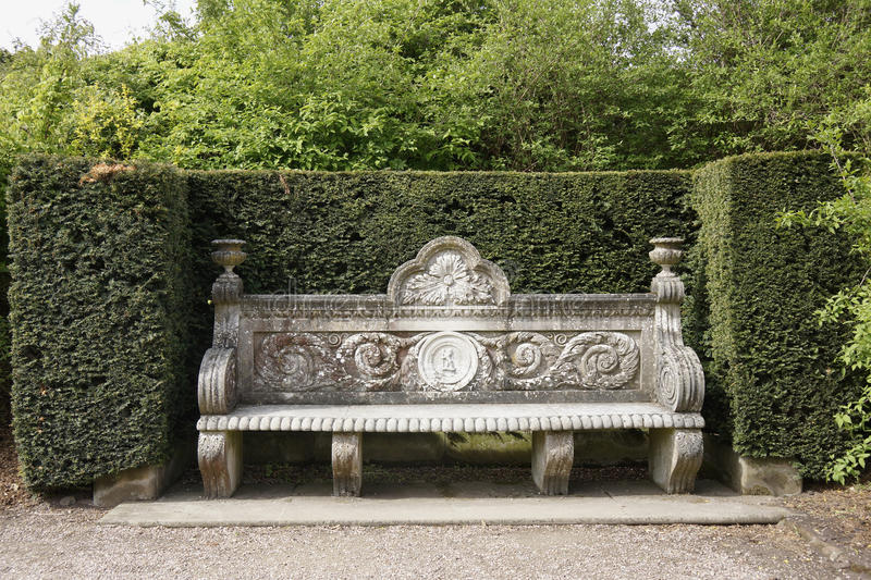 Ancient stone bench in park stock images