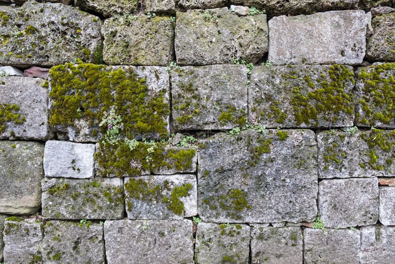 Ancient stone blocks forming rustic wall stock photos