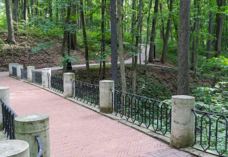 Bridge in the park. Ancient stone bridge in the green park stock photos