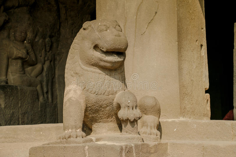 Ancient Stone Carving Art of a Lion. An ancient stone art, carving of a lion kept at Ellora Caves in Aurangabad, Maharashtra a UNESCO site stock photos