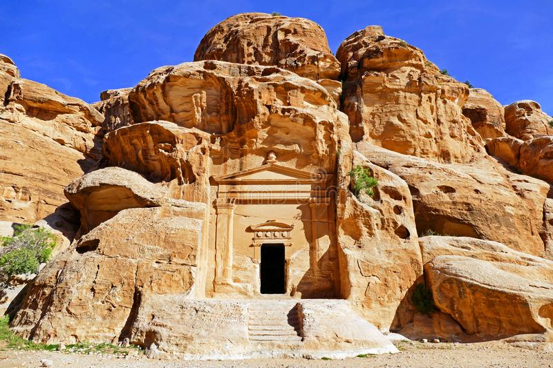 Ancient Stone Carvings Entrance of Little Petra, Jordan. Ancient Stone Carvings Scenic Entrance of Little Petra in Wadi Musa, Jordan in Summer stock photography