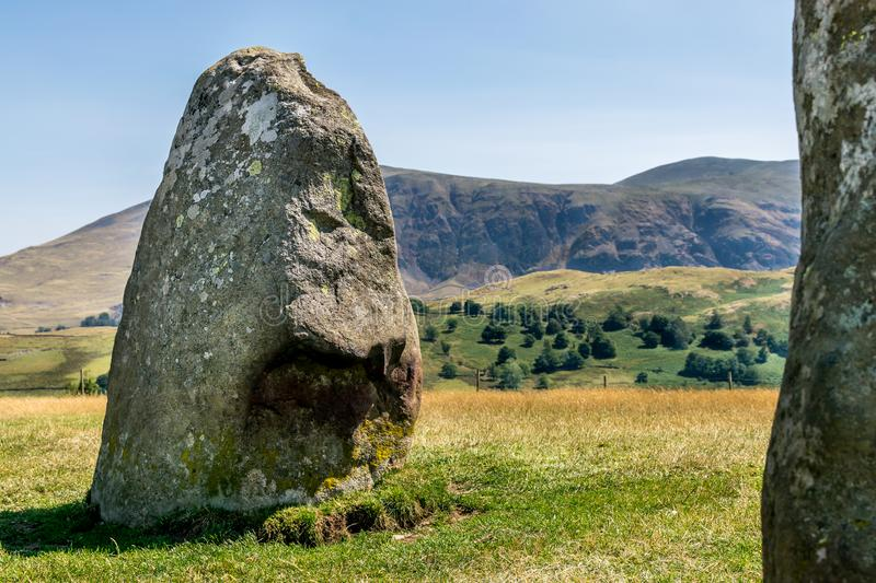 Ancient stone circle at castlerigg, with a mountain. A sunny summers day with a view of the stone circles from a bygone age. white fluffy clouds in the sky. a royalty free stock photography