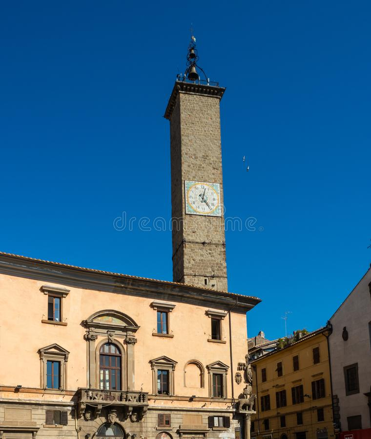 Ancient stone clock tower in the public square in the old town of Viterbo, Italy.  royalty free stock photos
