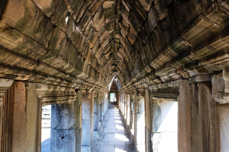 Ancient stone corridor bathed in sunlight. Stone vaults. Ancient stonework royalty free stock photos