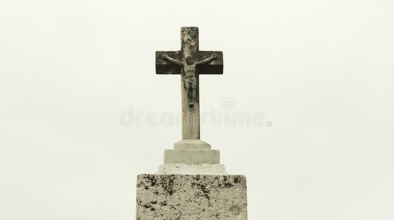 Ancient stone cross with Jesus Christ - son of God. Slvation by Jesus is stated as the saving of the person soul from sin and its consequences stock images