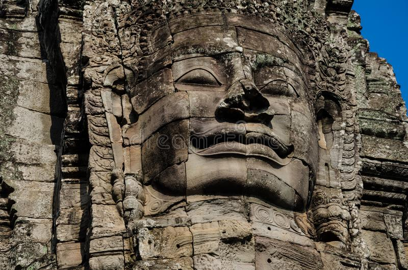 Ancient stone faces of Asian culture, in abandoned temples royalty free stock photos