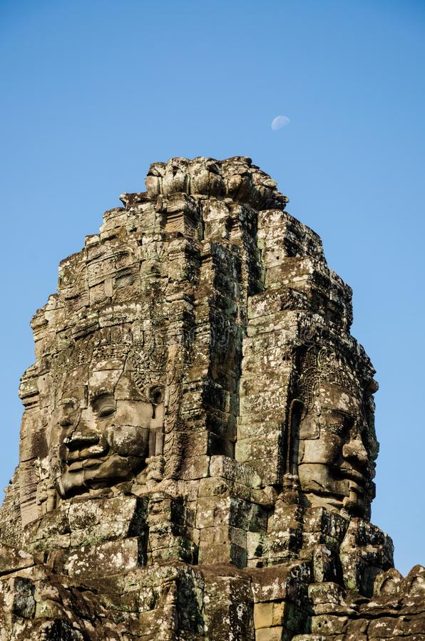Ancient stone faces of Asian culture, in abandoned temples royalty free stock image