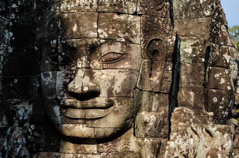 Ancient stone faces of Asian culture, in abandoned temples stock photos