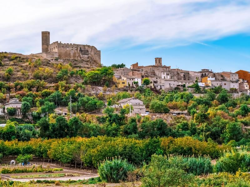 Ancient stone hilltop village in Catalonia Spain. Traditional Catalan autumn rural landscape with medieval houses, castle and. Chapels among olive fields royalty free stock images