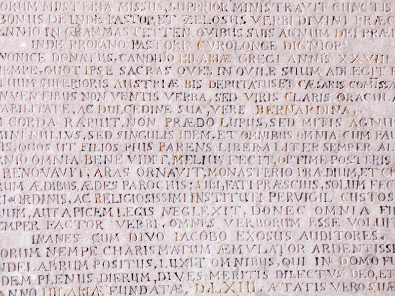 Ancient stone with Latin text royalty free stock photo