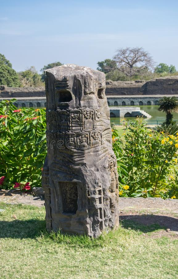 Ancient Stone Pillar of old building with Carvings. Showing some geometric figures floral pattern royalty free stock images