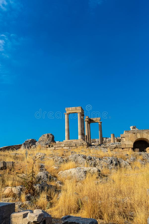 Ancient stone pillars of acropolis Lindos. View from below of ancient stone pillars of the acropolis of Lindos, Greece stock images
