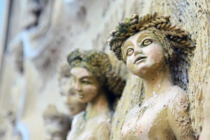Ancient stone sculptures of female images with elements of corrosion. Outdoors, outside royalty free stock image