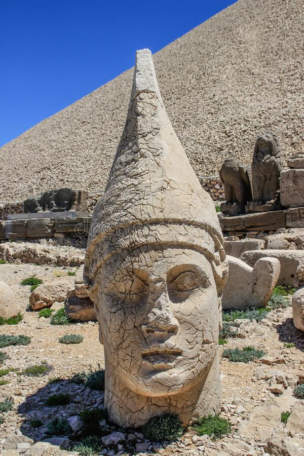 Ancient stone sculptures of kings and animals on Mount Nemrut Nemrut Dag. Monumental tomb made for Antiochus, Adiyaman, Turkey royalty free stock photo