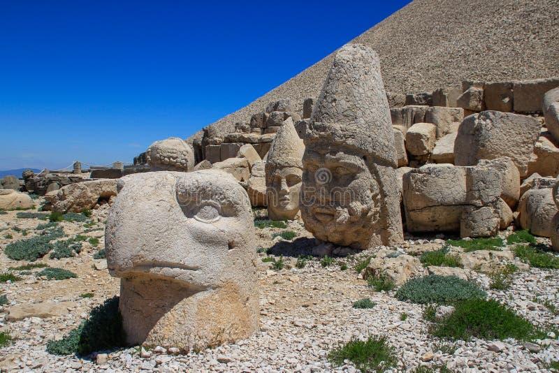 Ancient stone sculptures of kings and animals on Mount Nemrut Nemrut Dag. Monumental tomb made for Antiochus, Adiyaman, Turkey stock photos