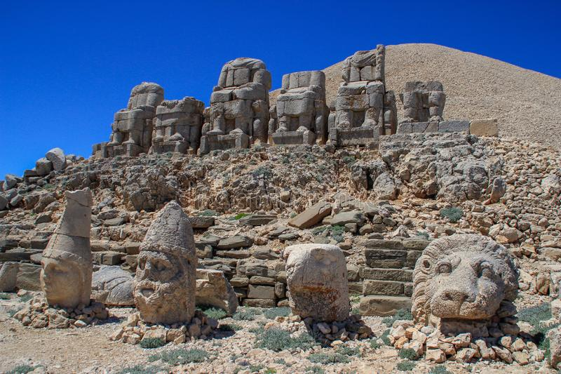 Ancient stone sculptures of kings and animals on Mount Nemrut Nemrut Dag. Monumental tomb made for Antiochus, Adiyaman, Turkey stock photography