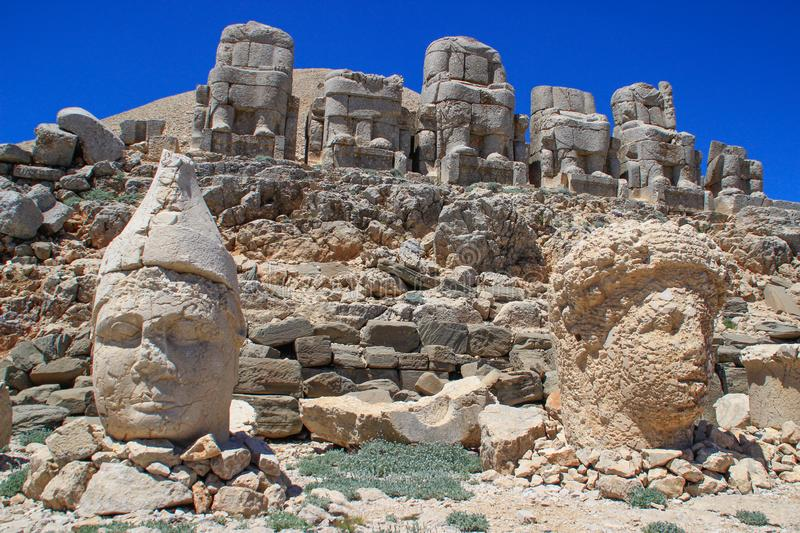 Ancient stone sculptures of kings and animals on Mount Nemrut Nemrut Dag. Monumental tomb made for Antiochus, Adiyaman, Turkey royalty free stock images