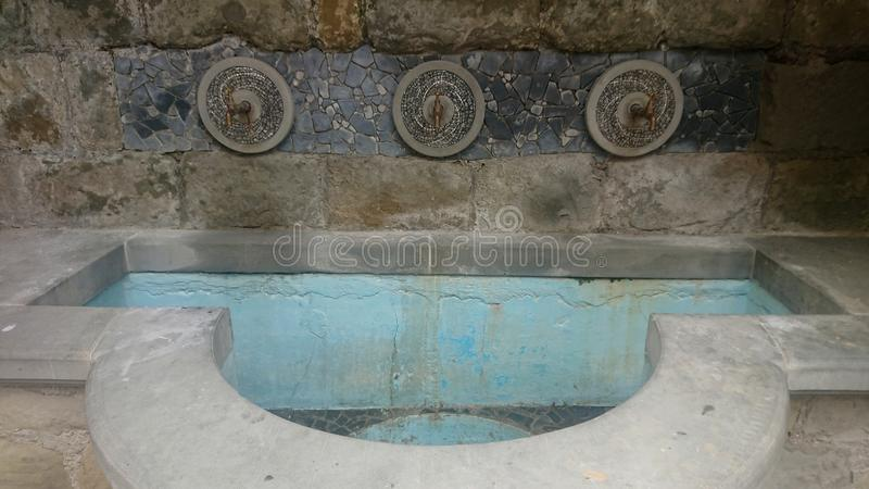Ancient Stone Sink in Grey and Blue. Water, tap royalty free stock images