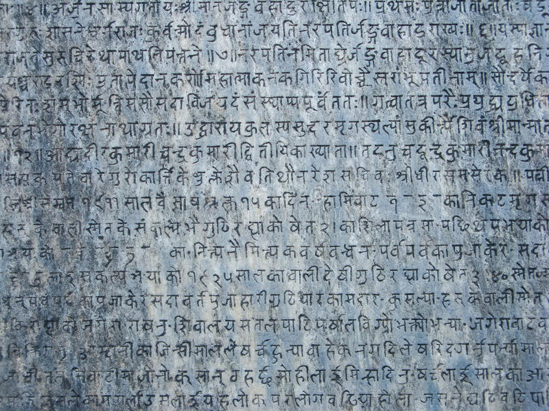 Ancient Stone Tablet. Ancient sanskrit text etched into a stone tablet stock photography