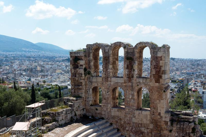 Ancient stone theater with marble steps of Odeon of Herodes Atticus on the southern slope of the Acropolis. Athens, Greece. The Odeon is the main scene of the stock images