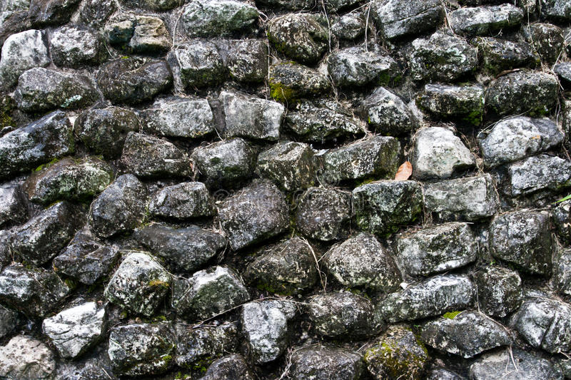 Ancient stone wall texture royalty free stock photography
