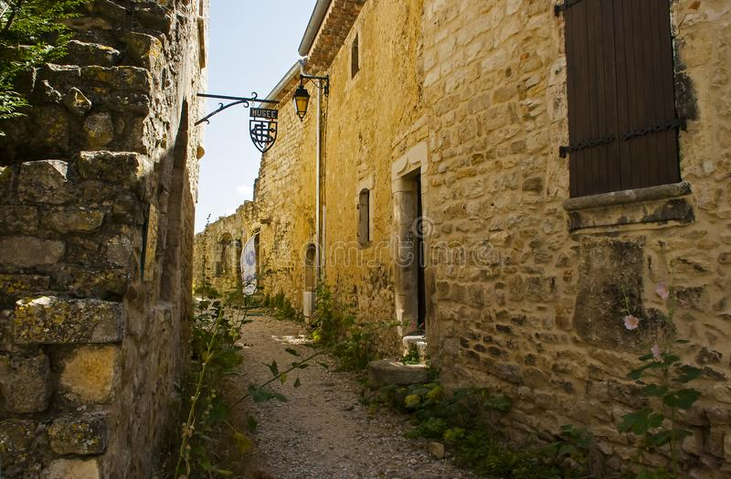 Ancient stone walls and narrow gravel streets in the historic French village of Le Poet Laval in the Drome area of Provence royalty free stock photos