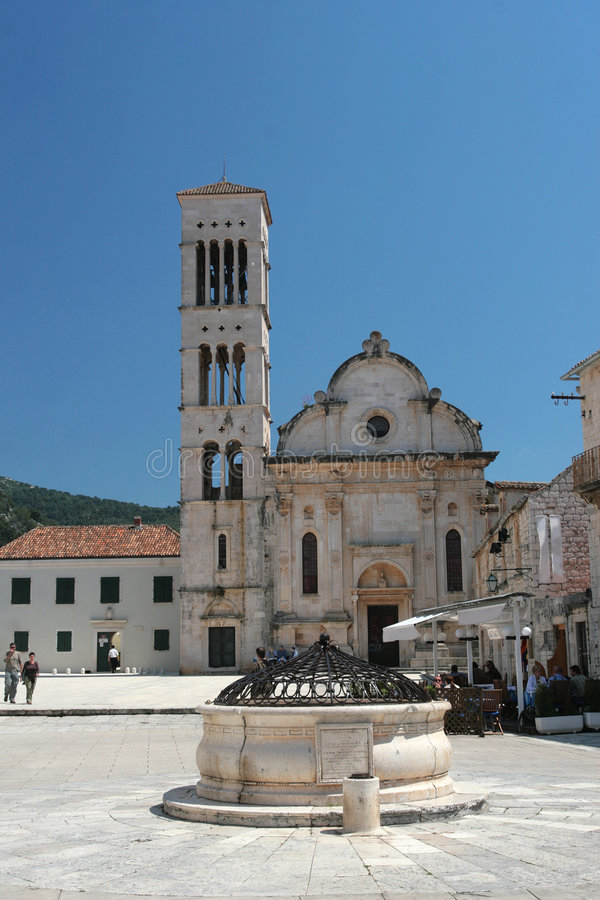 Ancient stone well and cathedral in Hvar, Croatia royalty free stock photos
