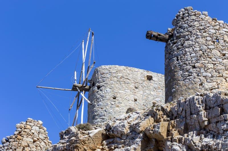 Ancient stone windmills Lassithi area, island Crete, Greece. Ancient, historic, famous, dilapidated stone windmills on a sunny day Lassithi area, island Crete stock photos