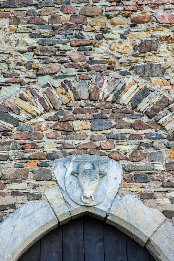 Ancient stone work above a castle doorway royalty free stock photo