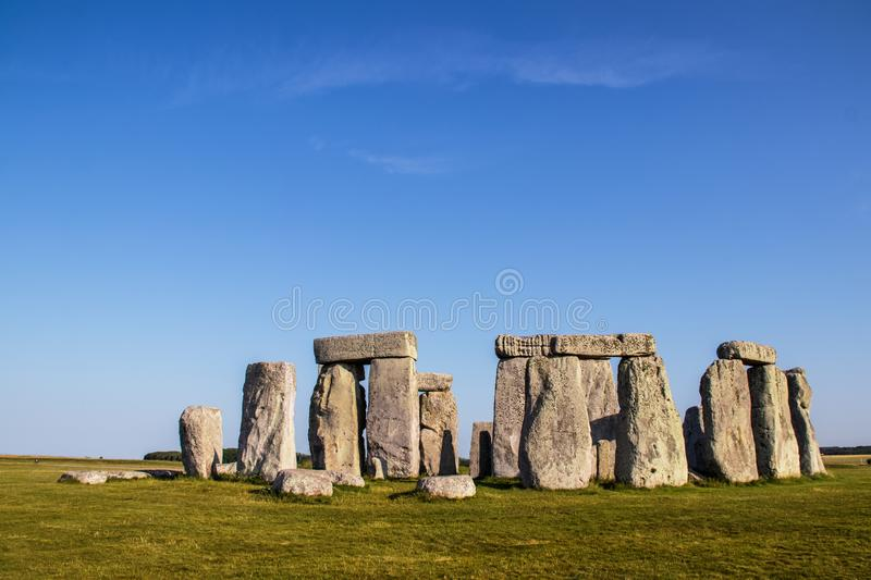 Ancient Stonehenge - standing rocks - in Great Britain under a beautiful blue sky on a sunny day with contrasting shadows.  royalty free stock image