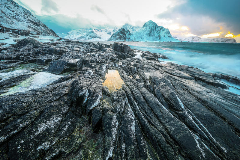 Ancient stones on the shores of cold Norwegian Sea at evening time. Lofoten islands. Beautiful Norway landscape. Ancient stones on the shores of cold Norwegian royalty free stock images