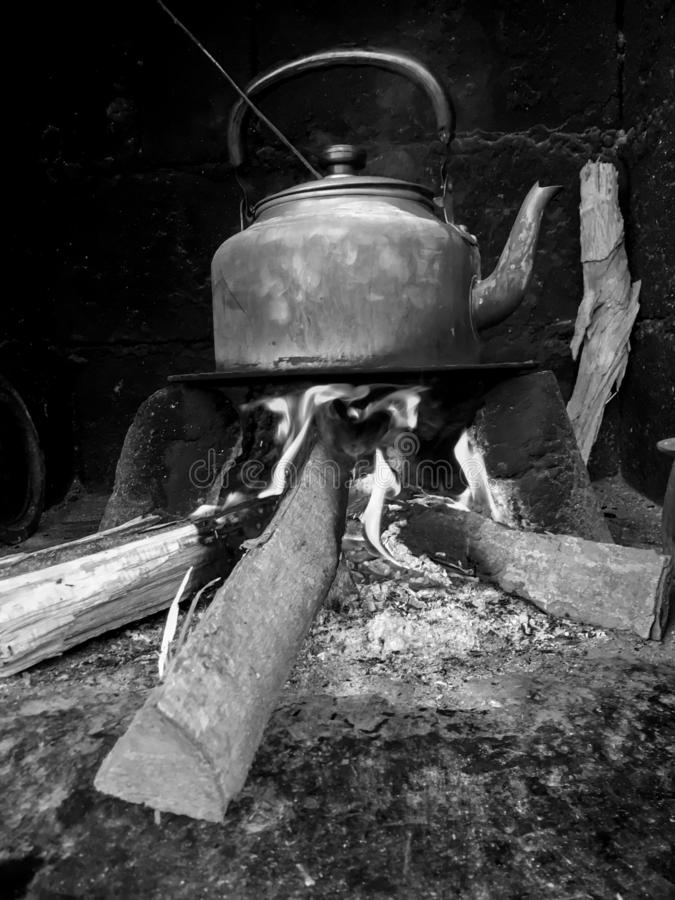 Ancient stove using pieces of wood to light fire stock photography