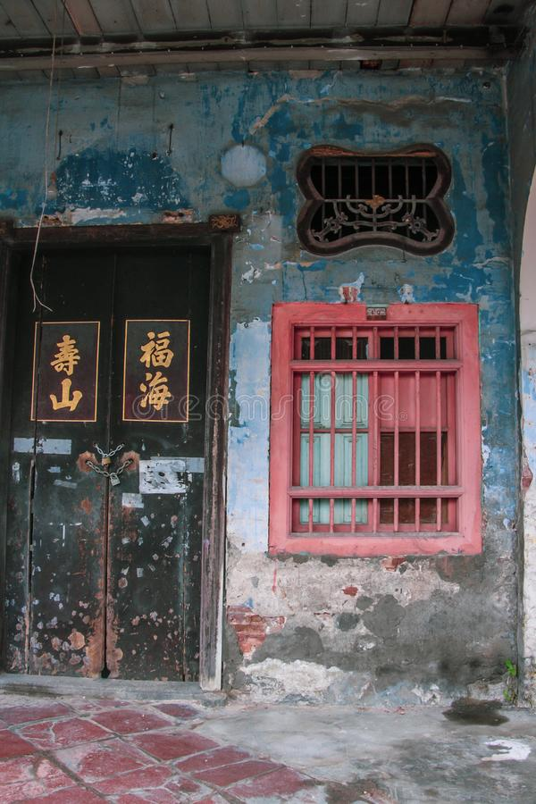 The ancient streets of Georgetown, Malaysia. Old walls and doors with blue and pink. The ancient streets of Georgetown, Malaysia. Old walls and doors shabby with stock photo