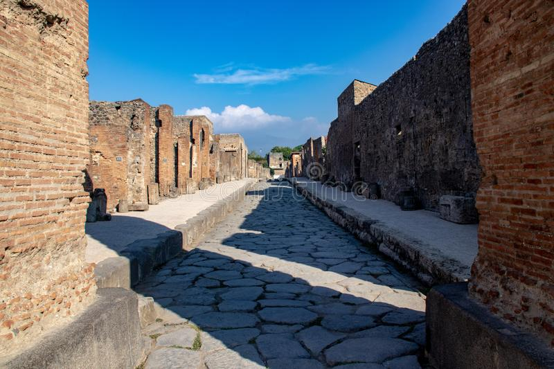 The Ancient Streets of Pompeii. The streets and damaged buildings in the ancient Roman city of Pompeii, Italy resulting from the Mount Vesuvius eruption of 79 AD royalty free stock photography