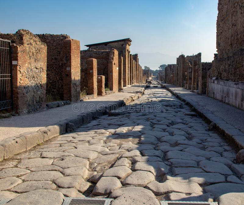 The Ancient Streets of Pompeii. The streets and damaged buildings in the ancient Roman city of Pompeii, Italy resulting from the Mount Vesuvius eruption of 79 AD royalty free stock photo