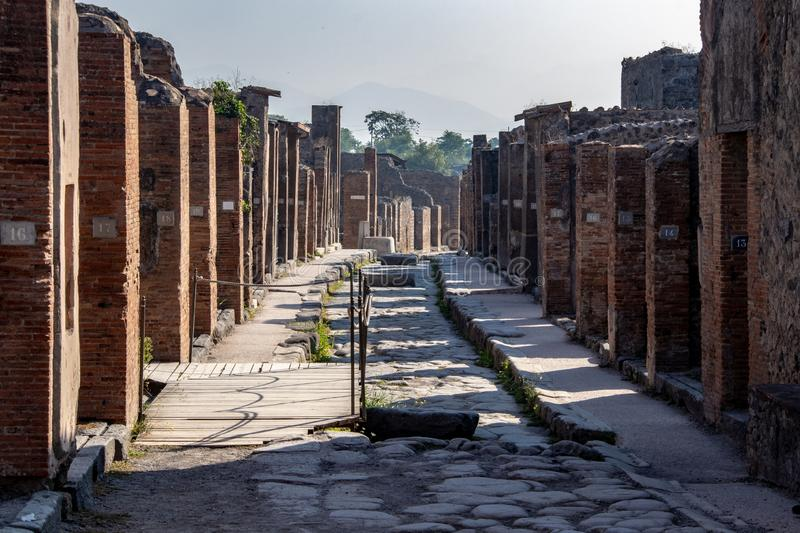 The Ancient Streets of Pompeii. The streets and damaged buildings in the ancient Roman city of Pompeii, Italy resulting from the Mount Vesuvius eruption of 79 AD royalty free stock image