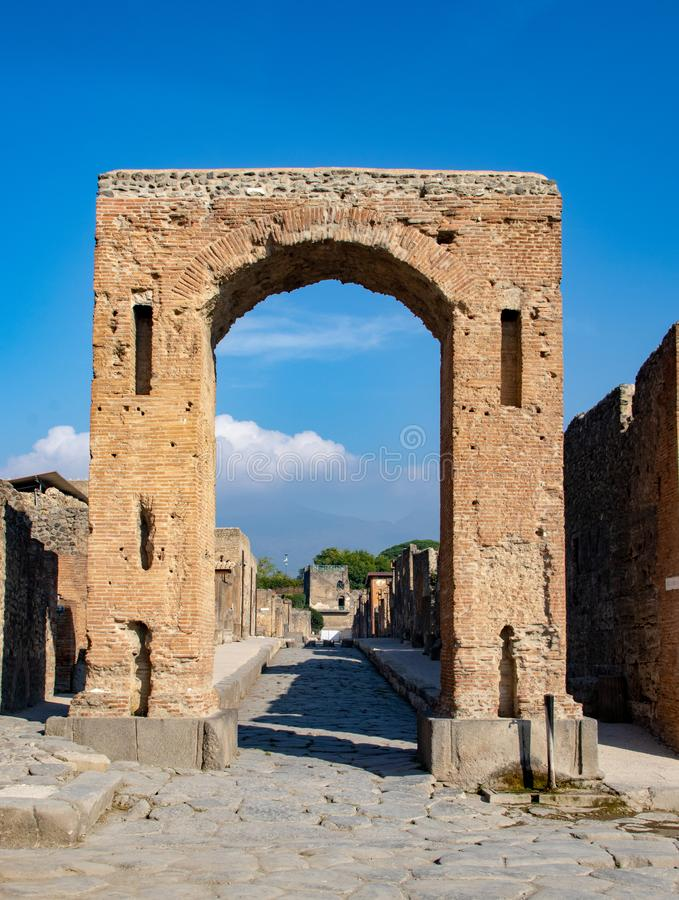 The Ancient Streets of Pompeii. The streets and damaged buildings in the ancient Roman city of Pompeii, Italy resulting from the Mount Vesuvius eruption of 79 AD royalty free stock images