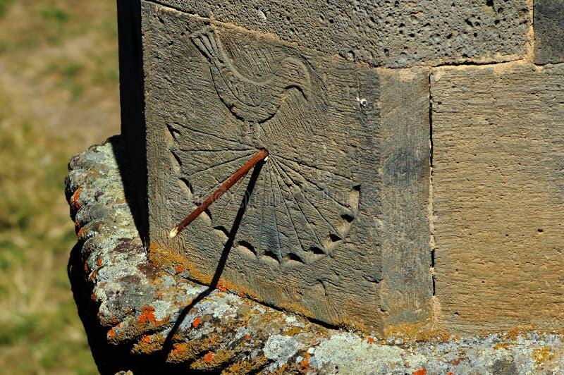 Ancient Sundial. Ancient ornamental sundial on old column. Armenia, Tatev Monastery stock image