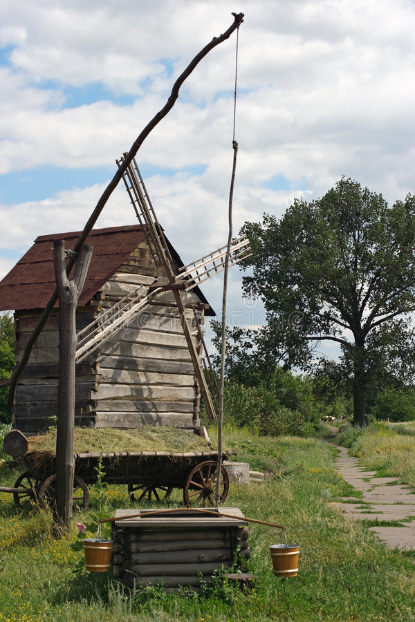 Ancient sweep and windmill stock images