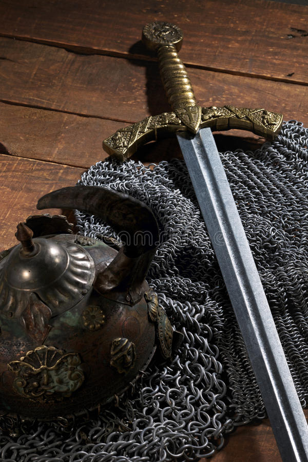 Ancient sword, chain armor and the soldier's helmet with horns royalty free stock photography