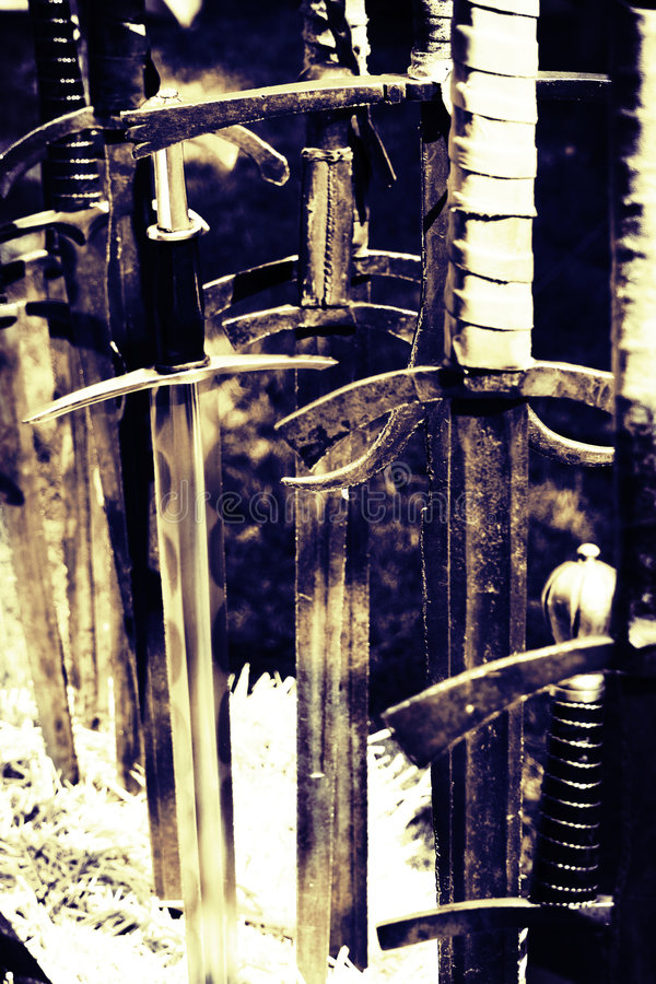 Ancient swords. A closeup of some ancient swords in a local town festival in Italy stock images
