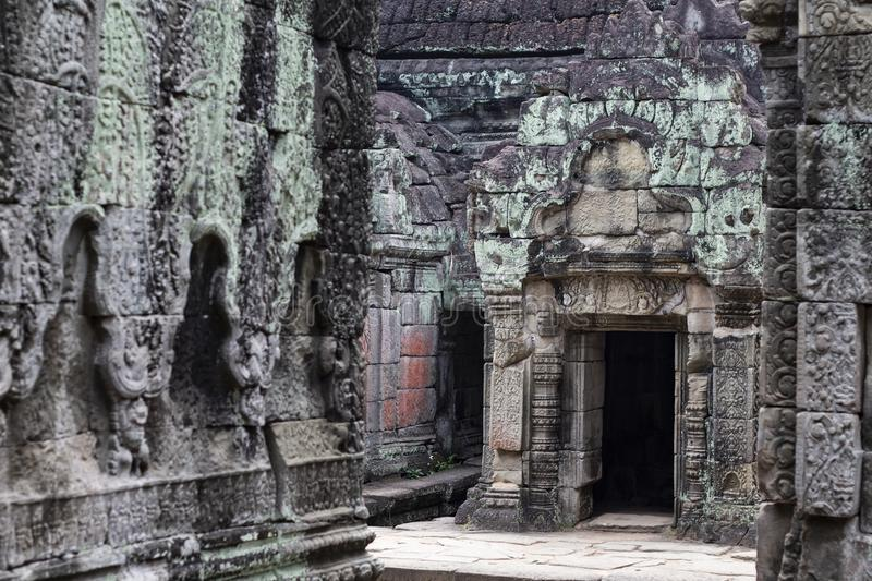 Ancient temple in Angkor Wat. Preah Khan temple mossy stone bas-relief ornament. Buddhist or hindu temple. stock photos