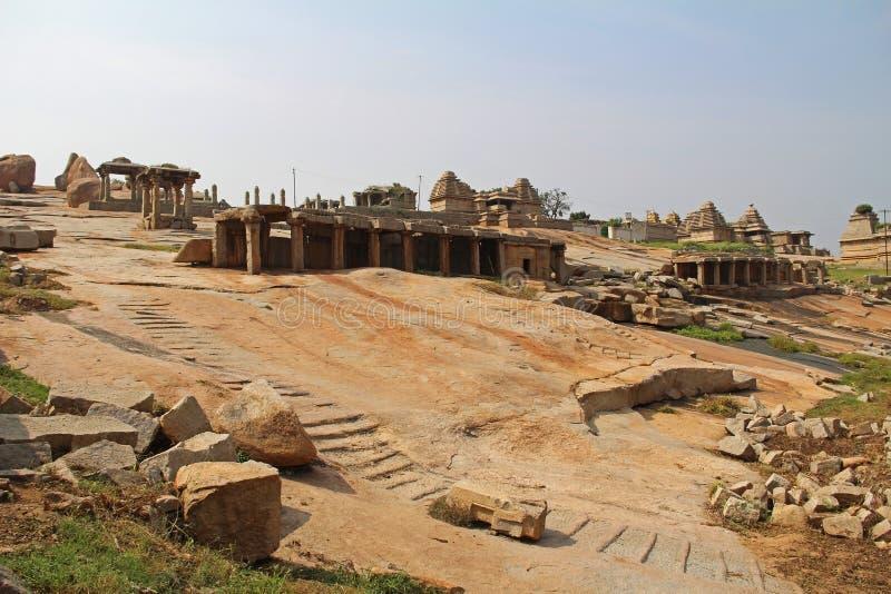 An ancient temple complex Hemakuta hill in Hampi, Karnataka, India. Unesco World Heritage Site. The famous tourist destination from GOA stock image