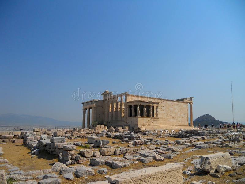 Ancient Temple Erechtheion on Acropolis hill. A caryatid is a sculpted female figure serving as an architectural support taking the place of a column or a pillar stock photo