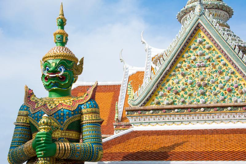 Ancient temple guardian in front of Temple of Dawn Wat Arun Buddhist Temple is green demon giant statue. royalty free stock images