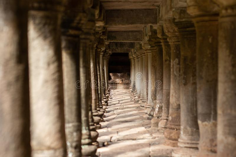 Ancient Temple Pillars Under a Walkway in Angkor Thom, Cambodia stock photography
