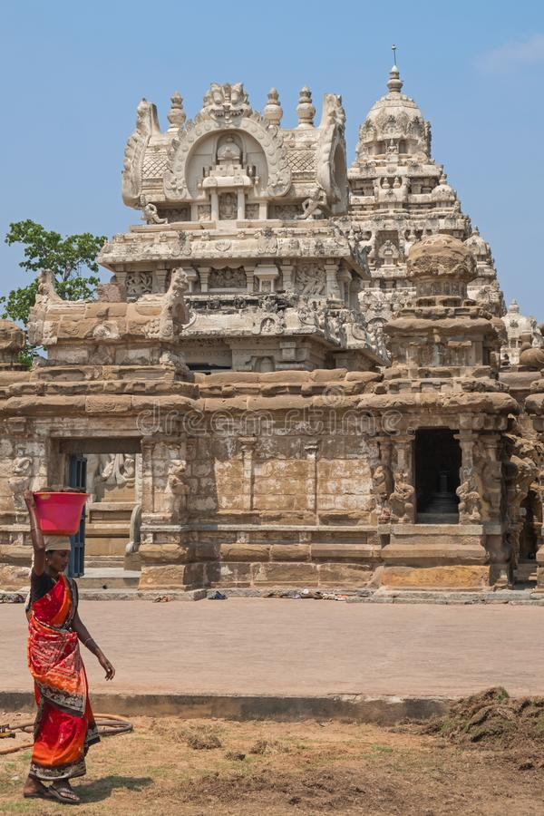 Ancient temple in Tamil Nadu. Kanchipuram, India - March 18, 2018: Unidentified local woman passing on front of the entrance to the 8th century Kailasanathar stock photos