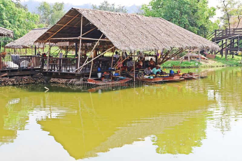 The ancient Thai lifestyle. Karnchana buri, Thailand: January 20, 2019: Life nearby the river. Simulating the ancient Thai lifestyle at Mallika city, 1905 A.D royalty free stock photography