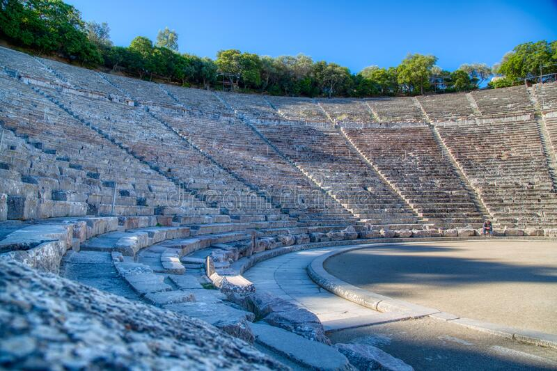 The ancient theater of Epidaurus, Peloponnese, Greece. The ancient theater of Epidaurus or `Epidavros`, Argolida prefecture, Peloponnese, Greece royalty free stock images