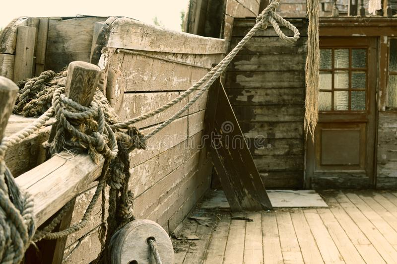 The ancient thrown wooden ship of pirates. stock photos